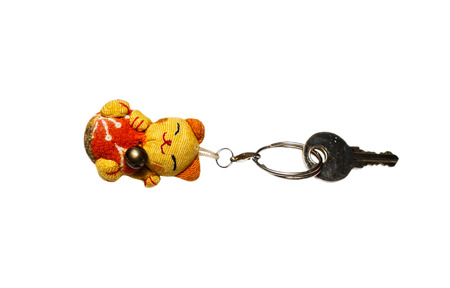 key chain: key chain in shape kitten lucky doll isolated on a white background.