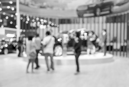 show room: abstract blurred photo of motor show exhibition , car show room , Black and white colors. Stock Photo
