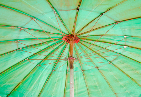 sunshade: Bottom view of old green umbrella. Stock Photo