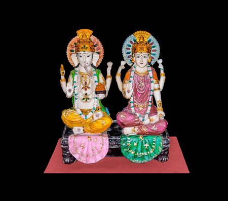 Goddess Lakshmi and Lord Ganesh isolated on black background , copy space on photo for document. Stock Photo