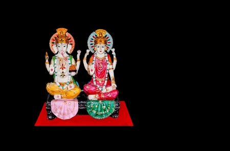 lakshmi: Goddess Lakshmi and Lord Ganesh isolated on black background , copy space on photo for document. Stock Photo