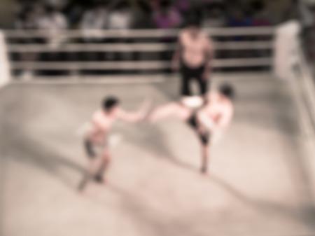 boxing match: Abstract blur original  muay-thai boxing match vintage photo style. Stock Photo
