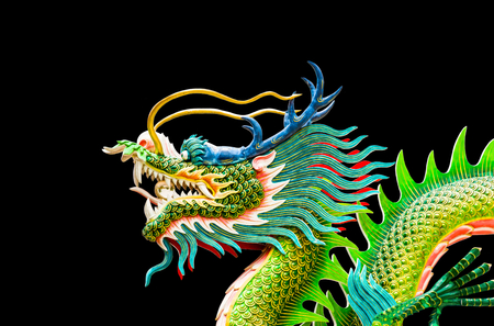 Colorful dragon statue on black  background.