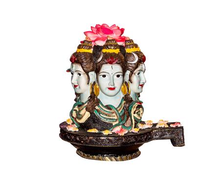 Statues of three head hindu deities isolated on white background.