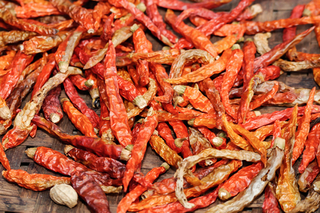 Red hot chilly pepper background. Chilly pepper drying on the sun. Stock Photo