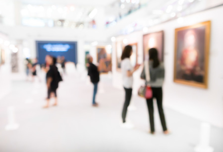 Abstract blurred people at the photography museum. Banco de Imagens