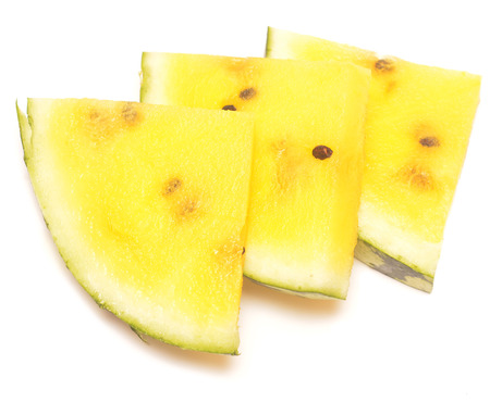 yellow watermelon slices isolated on white background photo