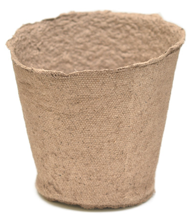 peaty: Peat pot for growing seedlings isolated on white background