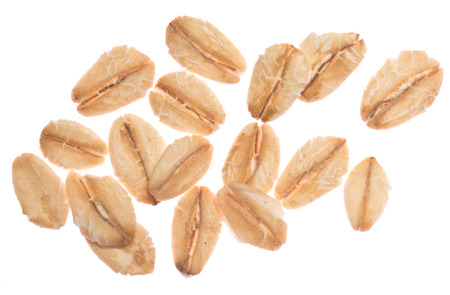 Oat flakes isolated on white background