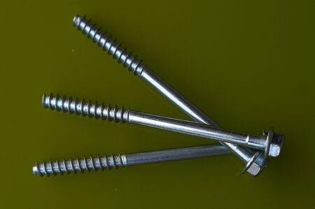gudgeon: Three screws lying horizontally on a table