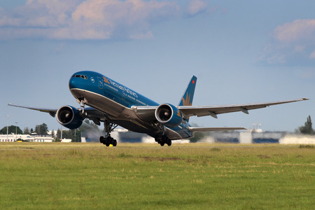 PRAGUE, CZECH REPUBLIC - JULY 01: Vietnam Airlines Boeing B777-2Q8ER takes off from PRG Airport on July 01,2013. Vietnam Airlines is the national flag carrier of Vietnam