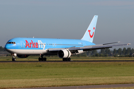 AMSTERDAM - JULY 02: ArkeFly (TUI Airlines Nederland) Boeing 767-383ER lands at AMS Airport in Netherlands on July 02, 2012. ArkeFly is a Dutch charter airline Main base is Amsterdam Schiphol Airport