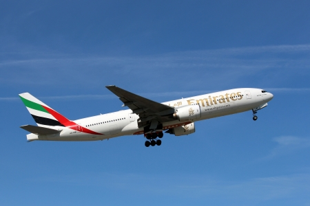 PRAGUE, CZECH REPUBLIC - JULY 23: Boeing 777 Emirates climbs after take off from PRG Airport in Czech Republic on July 23, 2012. Emirates is the largest airline in the Middle East.