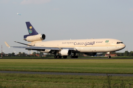 AMSTERDAM - JULY 04: McDonnell Douglas MD-11F Saudia lands at AMS Airport in Netherlands on July 04, 2012. Saudi Arabian Airlines operating as Saudia is the flag carrier airline of Saudi Arabia.
