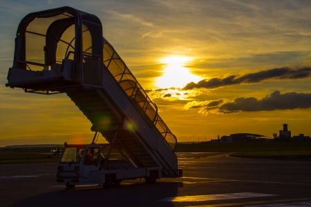 A ramp of the plane at the airport at sunset photo