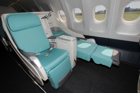economy: Seats in business class
