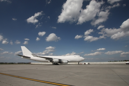 off ramp: White plane on cargo apron of the airport
