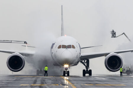 PRAGUE, CZECH REPUBLIC - DECEMBER 16: De-icing LOT Polish Airlines, Boeing B787 Dreamliner at Prague Airport on December 16, 2012. Polish Airlines, is the flag carrier of Poland. Based in Warsaw.