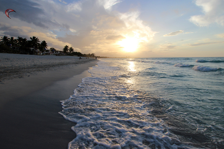 Sandy beach with the ocean at sunset Stock Photo