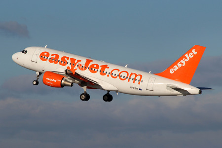 PRAGUE, CZECH REPUBLIC - JANUARY 12: EasyJet Airline Airbus A319-111 takes off from PRG Airport on January 12, 2014. EasyJet is the low cost airline of the United Kingdom Editorial