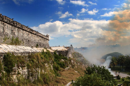 Burning of grass at the fortress El Morro in Cuba photo