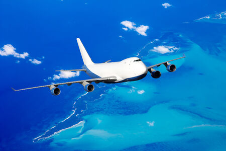 Huge white cargo plane in flight over the Bahamas photo