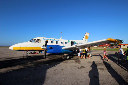 scheduled: VARADERO, CUBA - FEBRUARY 08: Embraer EMB-110 Aerocaribbean prepares to fly to Cayo Largo on February 08, 2014. Aerocaribbean Airlines operates scheduled domestic passenger services.