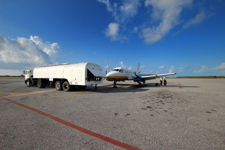 fueling pump: Small aircraft refueling at airport on the island of Cayo Largo