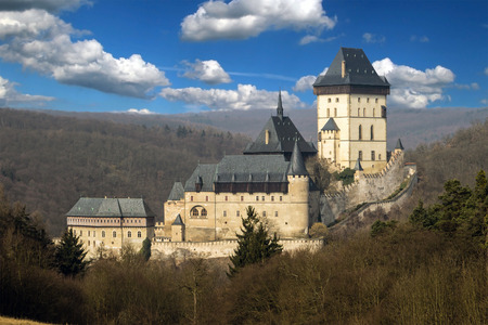 crenelation: Karlstejn Castle west of Prague with beautiful sky full of white clouds Editorial