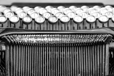 Black and white close-up photo of old typewriter photo