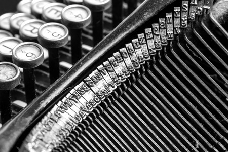 Black and white close-up view of an old typewriter photo