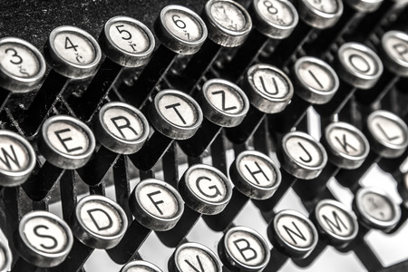 Black and white close-up view of an old typewriter keys