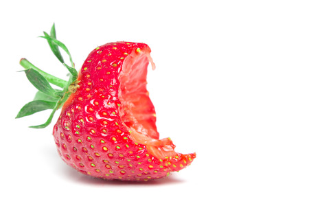 Bite strawberry on a white background