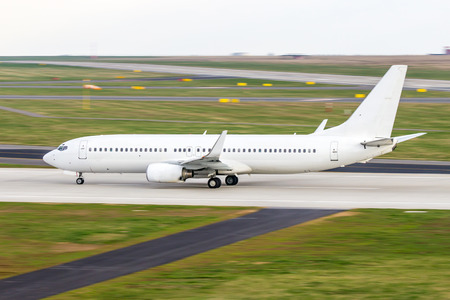 airplane take off: All white plane on the airport runway Stock Photo