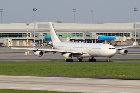 All white plane taxiing on the airfield photo