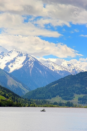 Fishermen on the Zeller See with beautiful mountains in the background photo
