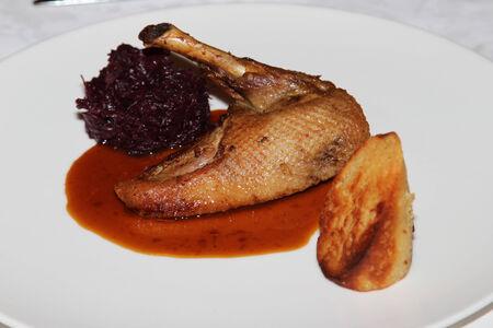 Meal duck with sauerkraut and dumplings photo