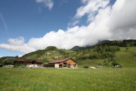 Summer sunny Alps with beautiful white clouds in the mountains photo