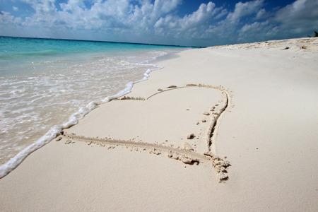 Big heart on the white sand beach photo