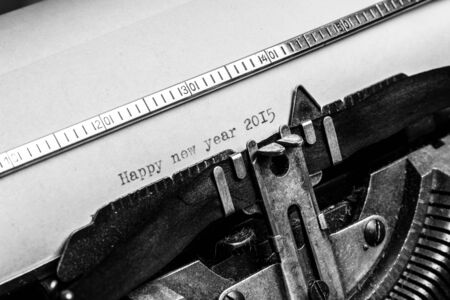 Inscription Happy new year 2015 written on an old typewriter photo