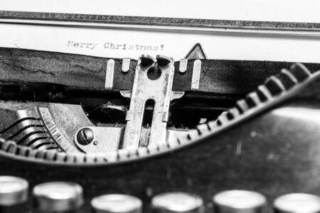 Inscription Merry Christmas! written on an old typewriter photo