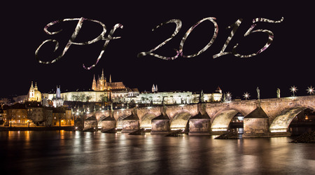 The inscription PF 2015 above the panorama of Prague Castle with Charles bridge photo