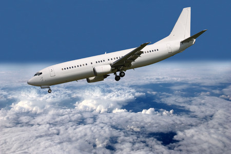 aircraft landing: Steep descent aircraft landing gear and flaps Stock Photo