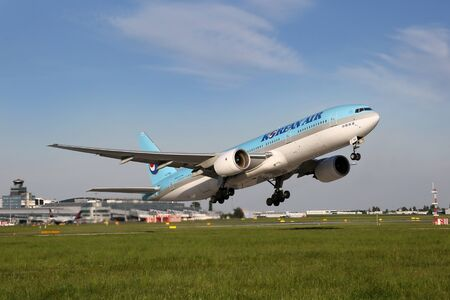 PRAGUE, CZECH REPUBLIC - MAY 13: Korean Air Boeing 777-2B5ER takes off from PRG Airport on May 13, 2015. Korean Air is the flag carrier airline of South Korea.