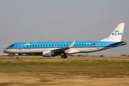 klm: PRAGUE, CZECH REPUBLIC - JULY 31: KLM Cityhopper Embraer 190STD lands at PRG Airport on July 31, 2015. KLM Cityhopper  is the flag carrier airline of the Netherlands.