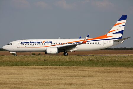 PRAGUE, CZECH REPUBLIC - JULY 31: Smart Wings Boeing 737-8Q8 lands at PRG Airport on July 31, 2015. Smart Wings is a brand of the Czech Travel Service Airlines.