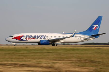 leases: PRAGUE, CZECH REPUBLIC - JULY 31: Travel Service Boeing 737-8AS lands at PRG Airport on July 31, 2015. Travel Service operates charter flights and also wet and dry leases aircraft to other airlines. Editorial