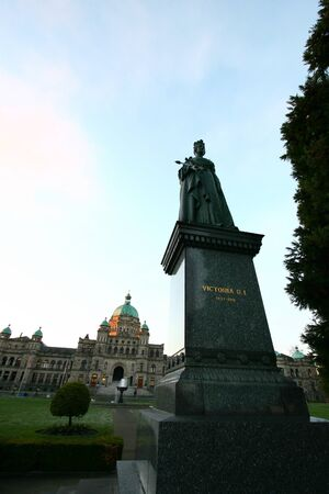 queen victoria: BC Parliament building in Victoria with Queen Victoria  statue at the front of the picture