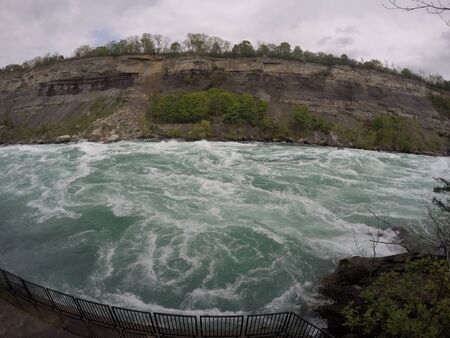 Niagra Falls rapids walk beside the water flow with a view of crushing waves