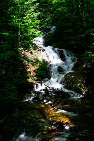 Gatineau park waterfall pictures capturing running water with the trees surrounding it